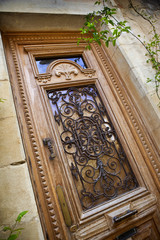 Wooden and wrought iron door of an old French house
