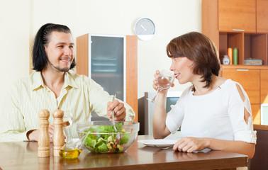 eating vegetables salad in home