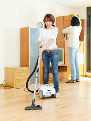Happy couple doing housework