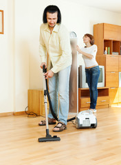 couple are doing house cleaning