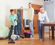 Happy family doing housework