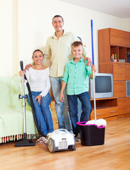 happy family  finished cleaning in home