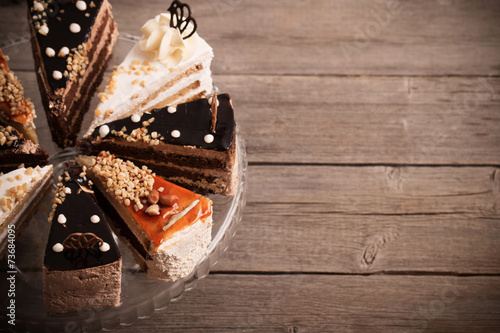 cake on old wooden background - 73684095