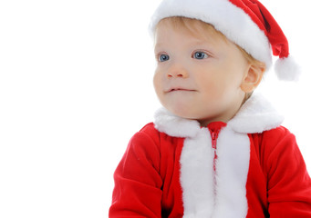 Cheerful boy in Santa Claus hat