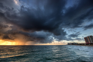 Rain at sunrise over ocean.