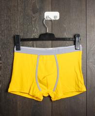 Brand new vivid yellow slips on the hanger