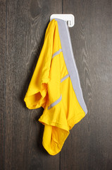 Messy yellow man underwear hanged on the wall