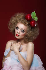 Artistry. Styled Woman with Two Apples on her Head