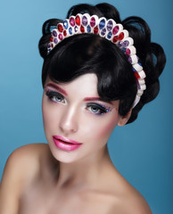 Glamor. Beautiful Brunette in Crown with Jewels