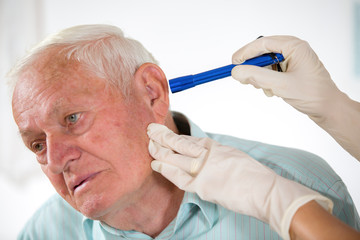 Doctor looking into patient's ear
