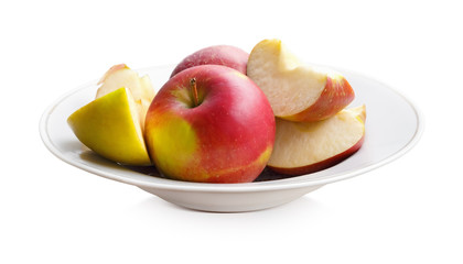 Apples on a white plate