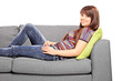 Young relaxed woman lying on a couch