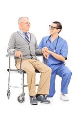Male nurse talking to a senior patient