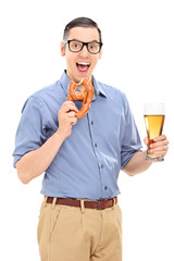 Man eating a pretzel and drinking beer
