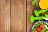 Dumbells, tape measure and healthy food. Fitness and health