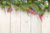 Fototapety Christmas wooden background with fir tree