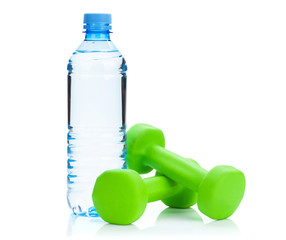 Two green dumbells and water bottle. Fitness and health