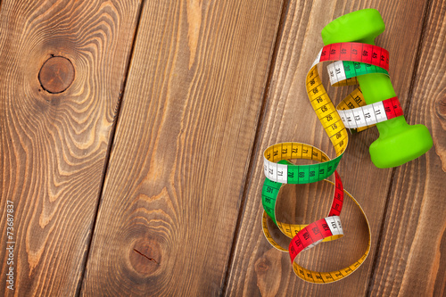 Tuinposter Gymnastiek Dumbell and tape measure