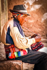 Old men knitting at taquile island in puno peru