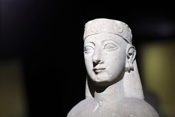 Ancient sculpture of woman