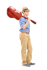 Young guy holding an acoustic guitar