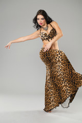 Young sexy woman in leopard dance costumes