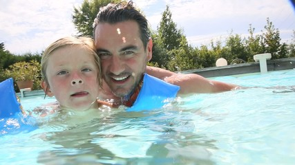 Father and son in swimming pool