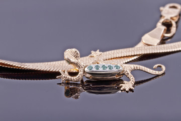 Unusual gold pendant in the form of a lizard
