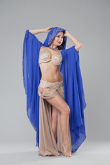 Portrait of the young sexy woman in blue tunic Arabic