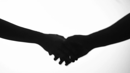 hand shake man and woman in silhouette