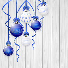 Blue Christmas balls and tinsel on wooden background