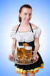 Young waitress with beer on white