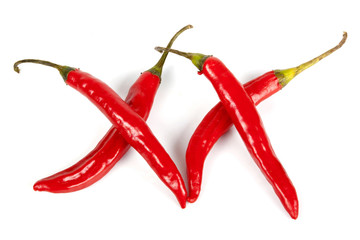 Four Shiny Red Chillies in Shape of XX