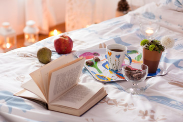 Breakfast served in bed with tea, chocolate and fruit