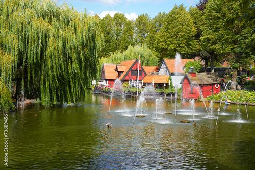 Staande foto Scandinavië A beautiful pond with fountain in Tivoli gardens in Copenhagen.