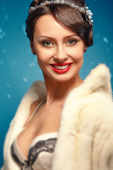 glamor girl in a white fur coat with red lips
