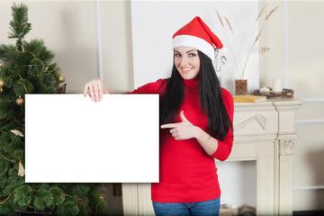 Christmas girl holding a sign