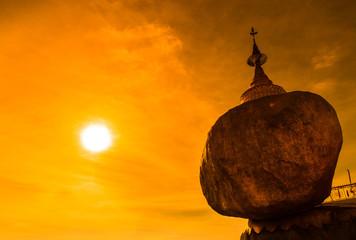 Golden rock called Kyaikhtiyo pagoda in the sunset, Myanmar