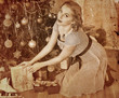 Woman receiving gifts.  Sepia toned.