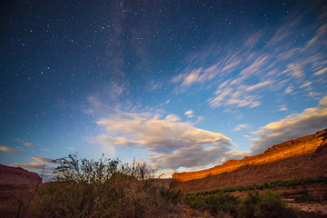 Bright Starry night with a Milky canyon lid by a rising moon lig
