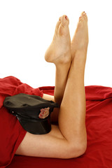 woman legs under red sheet police hat by knees