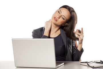 young beautiful businesswoman has a pain in the neck