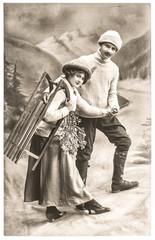 happy young couple outdoors with sledge. winter holidays