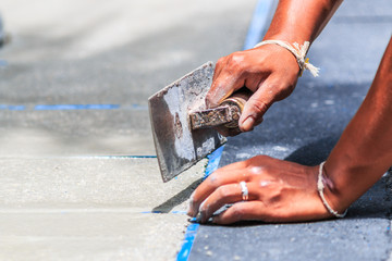 Worker smooth the cement  with trowel
