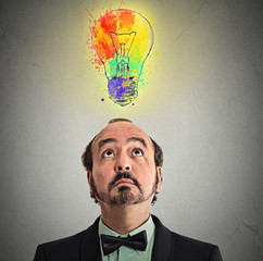 businessman came up with solution answer lightbulb above head