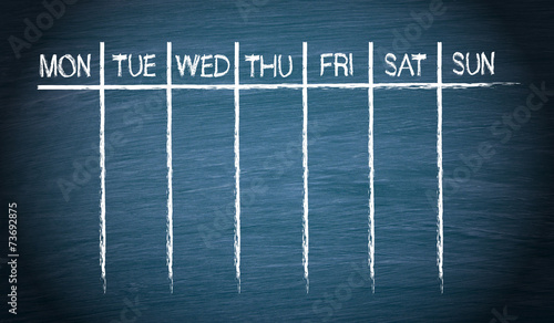 Weekly Calendar on blue chalkboard background - 73692875
