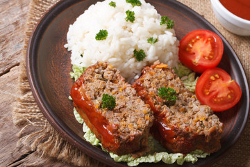 meat loaf with rice on a plate on a table