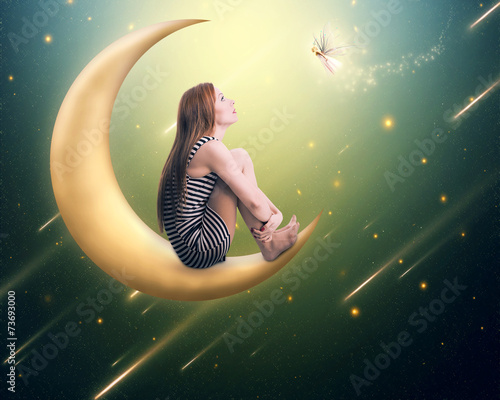 Leinwanddruck Bild lonely thoughtful woman sitting on the crescent moon