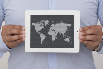 businessman holding a digital tablet with map
