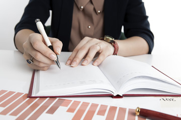 woman calculates future plans